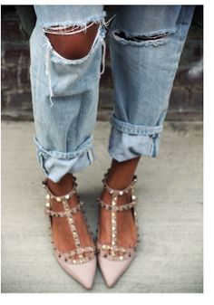 ripped jeans and designer shoes