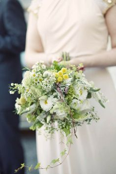 wild flower wedding bouquet contains white Veronica, large yellow cantered marguerites. Trailing variegated ivy Craspedia , small spray marguerites white rose and Lychnis coronaria (corn rose)