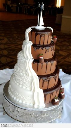 Bride and groom cake. The white side looks like it's the bride's veil/dress flowing down and the strawberries done up to look like they're wearing suits look like the suitors that couldn't make it to the top. Disappointingly, I cannot find the original source.