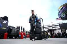 At-track photos: Friday at Martinsville Saturday, April 2, 2016 Kasey Kahne, driver of the No. 5 Great Clips Chevrolet, stands in the garage area during practice for the NASCAR Sprint Cup Series STP 500 at Martinsville Speedway. Photo Credit: Photo by Sean Gardner/NASCAR via Getty Images