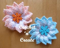 """""""A folded petal flower free crochet pattern, if you are like me and always looking for adornments for your crochet projects, this flower would be ideal. Make in reverse colors to add a touch of elegance."""""""