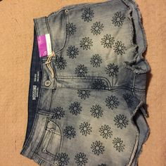 Mossimo high rise waist shorts These have the embroidery flower design . On front . They have a high waist and high rise . 63% cotton,  , 36% polyester, 1% spandex .NWOT Mossimo Supply Co. Jeans