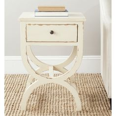 @Overstock.com - Safavieh Maxine Disstressd Vanilla End Table - Lend your space a vintage feel with this Safavieh wood end table. Featuring a distressed vanilla finish, this piece has a single drawer for stowing away bedside essentials, while the flat surface is great for a lamp or vase of flowers.  http://www.overstock.com/Home-Garden/Safavieh-Maxine-Disstressd-Vanilla-End-Table/8130027/product.html?CID=214117 $142.19