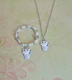 Children's Kitty Cat Necklace and Bracelet Set features a silver plated 14 inch necklace and a matching crystal and pearl beaded bracelet.  The Mermaid Apothecary via Etsy.com