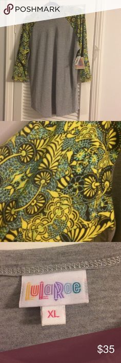 NWT. XL. LulaRoe Randy baseball tee. Super soft! Very soft baseball tee. Never worn with original tags. Green, yellow, blue floral print on arms. Too small for me or I would have kept this one for sure! XL. LuLaRoe Tops Tees - Long Sleeve