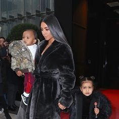 North West gets a lollipop on day out with mother Kim and brother Saint (324589)