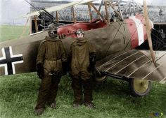 German pilot Richard Scholl and his co-pilot Lieutenant Anderer, in flight gear beside their Hannover CL.II biplane in 1918. ~ colourized photo