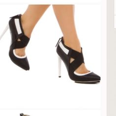 """Gx by Gwen Stefani Black &white pump Faux-leather and faux-croc pump with island platform and back zip. True to size. Outside heel height- 5"""". Inside heel height- 4"""". Gorgeous classic colors! Shoe Dazzle Shoes Heels"""