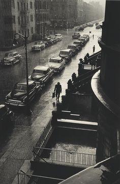 Man in Rain, West 88th St. (1952). Ruth Orkin.