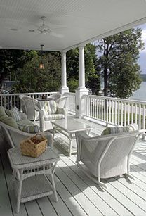 A porch at the lake house built for long summer days.