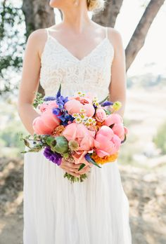 Brides.com: 20 Fresh Peony Bouquet Ideas. Long Beach, California-based florist Primal Flower created a colorful pink peony bouquet with a fresh-picked vibe. Purple wildflowers, orange zinnias, and greenery accents make for a perfect bohemian-chic arrangement.