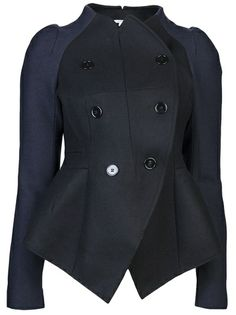 Two tone coat in marin from Carven. This wool blend double breasted coat features a round neck, asymmetric front button closure, and tonal stitching. Has two faux front pockets, long sleeves, and a two tone design in black and blue throughout.