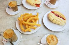 This is breakfast (stop 1) on the Malaga daytime food tour with Devour Malaga-- churros, coffee, and pan con tomate! So heavenly!