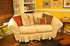 tuck. pin. done: no-sew loveseat slipcover in 30 minutes (she did a great job!)