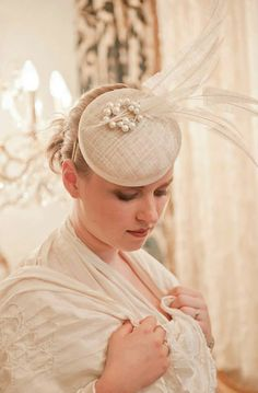 Dutch couture cream / off white bridal mini hat with lots off feathers and rhinestone embellishment by MarcusArtandFashion on Etsy https://www.etsy.com/listing/104674851/dutch-couture-cream-off-white-bridal