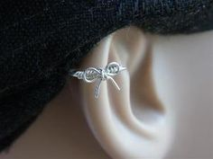 bow tie cartilage earring