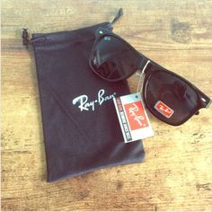 Classic black wayfarer sunglasses * Brand new with tags attached  * Will include protective drawstring sleeve  * Stamped on both arms and corner lens * 100% UV protection  * Classic and chic Accessories Glasses