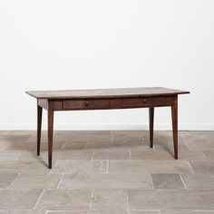 19th Century French kitchen or dining table. The top is made from 3 wide planks. This is a lovely honest example of a country piece of furniture.