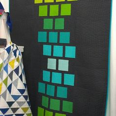 fun layout. great colors. great quilting inside colored squares.