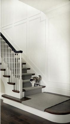 Stairway Millwork Wall paneling painted in Benjamin Moore Simply White Stairway Millwork Ideas Traditional Stairway Millwork Stair Paneling, Paneling Painted, White Wall Paneling, Paneling Ideas, Painted Stairs, Panelling, Beadboard Wainscoting, Stairway Wainscoting, Staircase Makeover