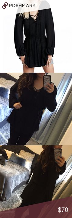 Free People Lace Up Tunic Pre-loved, still in great condition, no visible flaws // elastic waste band // so cute and can wear with so many different bottoms like pants, shorts, skirt // retail was $130 Free People Tops Tunics