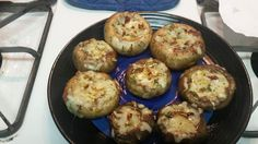 Grilled stuffed mushroom caps. The filling is a mixture of crumbled bacon, shredded Fontina cheese, chopped garlic, fresh thyme, crushed red pepper, sea salt, and just a dash of olive oil. It's important to brush the caps with oil before stuffing and grilling. Also, I recommend grilling them wrapped in a sheet of foil, rather than placing the caps directly on the grate (July 18, 2015).