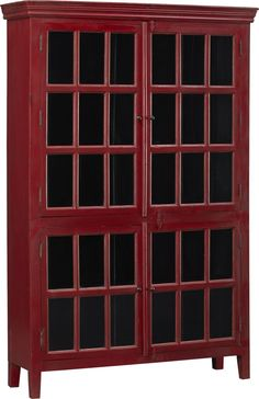 Stately storage.  This sizable piece has four glass-paned doors, opening to five fixed shelves.  Umber overtones add depth of character to the rich red finish. Shesham woodPigmented wax finishCrown mouldingHand-forged metal knobsWood hasp closuresMade in India.
