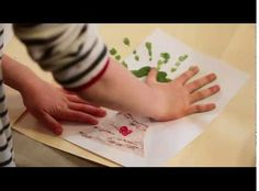 Valentine's Day Craft How-to Video from Handmade Charlotte: Easy Handprint Valentine's Card.