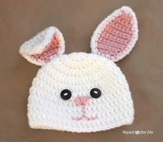 Repeat Crafter Me: Crochet Bunny Hat Pattern To do, but without the face, for cute effect.