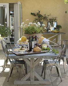 "House Beautiful article, ""Napa Valley Home with New Traditional Style"" features our Metal Bisto Chairs on the backyard patio. #potterybarn"