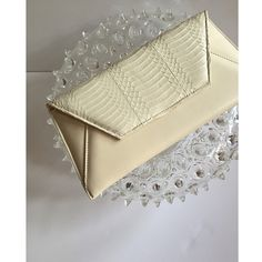 ONLY 1 piece left of our #Sona #Cream #Snakeskin Clutch. Works #perfectly with #jeans or a #cocktail #dress. Available at www.islyhandbags.com #clutch #madeintheusa #neutral #fashion #style #accessory #love #handbags