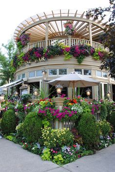 "One of the beautiful flower-covered restaurants in Niagara-on-the-Lake, Ontario, Canada. Another Poster: ""Restaurant in Niagara on the Lake in Southern Ontario, Canada."