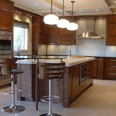 Example of wood grain Walnut horizontal grain kitchen - contemporary - Kitchen - Indianapolis - Susan Brook Interiors