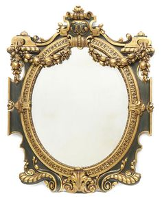 A Continental Baroque style parcel gilt and paint decorated mirror late 19th century