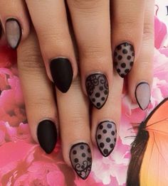 Black polka dots nail art design. Partner your polka dot design with a matte black color to make the design stand out even more.
