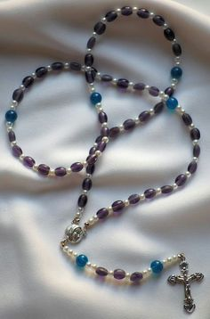 Purple and Blue Rosary by AllToolsPrayerful on Etsy.  This Rosary was created by my grand-daughter, a budding designer.
