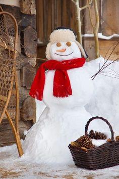 Even snowmen love log cabins!