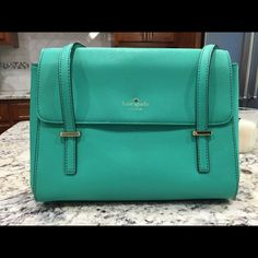 Kate Spade handbag Beautiful authentic Kate Spade bag. Mint green (it almost looks Tiffany blue in the picture). Price reflects damage. The handle is torn but could possibly be fixed? Otherwise excellent condition kate spade Bags
