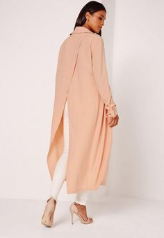 Damn girl, nice duster! This totally poppin' piece is the perfect finishing touch to any outfit and will polish off your fierce look nicely.  Featuring a split back with tie wrist detail and in a dreamy nude hue, wear with jeans a crop top ...