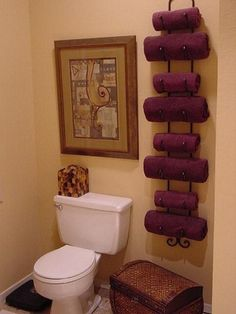 Storing Towels in a Wine Rack... genious!  Also love the chest below for larger towels, toilet paper or feminine items