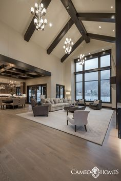 Cameo Homes Inc. has just completed building this Contemporary Rustic Home in Draper Utah. This living room features dark stained beams on the ceiling beautiful cabinetry by Chirs DickR Clean Living Room, Big Living Rooms, Design Living Room, Home Living Room, Apartment Living, Living Room Windows, Cozy Living, Dining Rooms, Dream House Interior