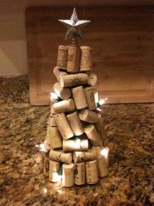 Wine cork tree...so cute. Paper cone, small string of lights, and some corks. Easy, cute & fairly simple.