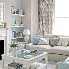similar shape of living room - could put shelves in the cut-out, and put couch against the window. Might need a focal point on the wall (no fireplace!)