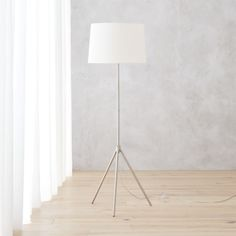 Shop saturday floor lamp.   Adjustable construction raises the bar on the classic tripod lamp by telescoping light up/down where you need it.  Slim shaft of tubular steel with brushed nickel finish ascends hi/lo from matching tripod base.