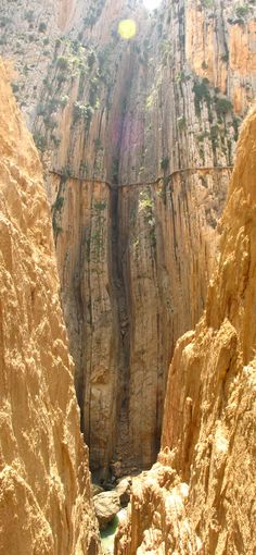Yipes!  El Camino del Rey (King's pathway) - Málaga, Spain. The walkway is one metre (3 feet and 3 inches) in width, and rises over 100 metres (350 feet) above the river below.  www.youtube.com/...