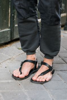 Barneys Men's Street Style Milan and Paris 2015. Those are not Thomas Maier sling back sandals. The caption in the article gives only a similar style as to what he is wearing. If you find out what these specific sandals are please let me know.