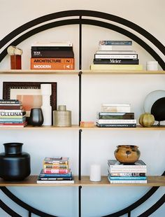 stacked books and objects (via Lonny Mag)