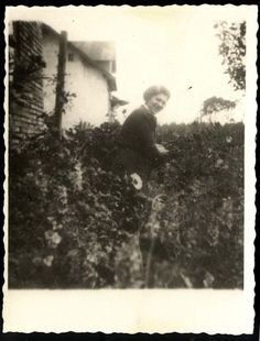 Trzebinia, Poland, A Jewish woman standing in a garden near a house. Poland Ww2, Florence Nightingale, Never Again, Woman Standing, Never Forget, Change My Life, Camps, Wwii, Portraits