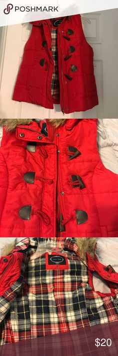 Red vest with faux fur lined hood Red puff vest with zipper and snaps. It is in like new condition, only worn twice by me. Jackets & Coats Vests