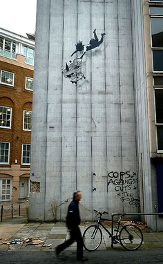 Banksy's war on London: in pictures - Telegraph - A disused building in Mayfair has become the latest target on Bristol street artist Banksy's London hit list. The piece, painted upon a disused building, shows a woman and her shopping trolley falling from a great height